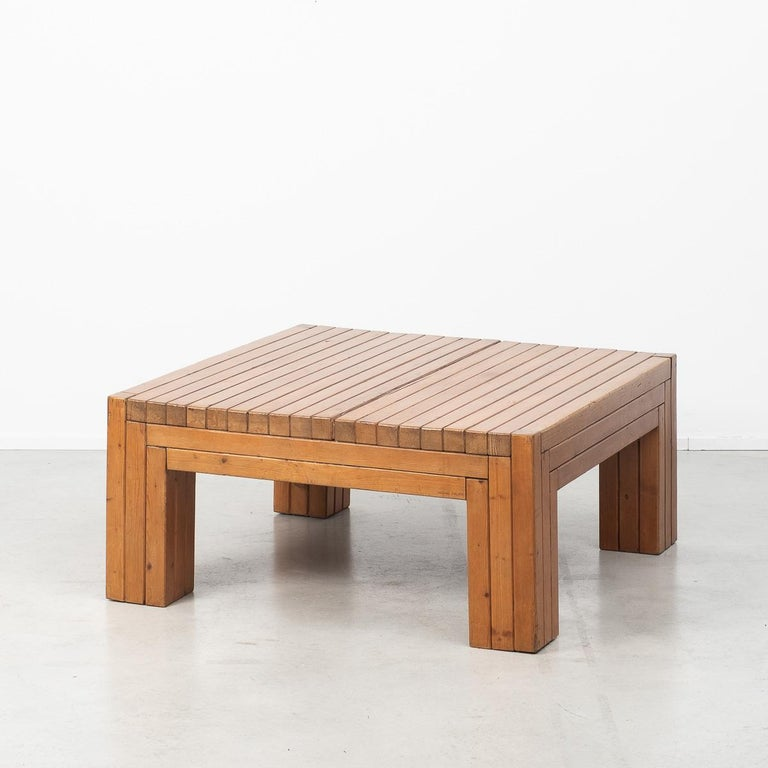 This solid wood coffee table, possibly made of elm, was designed and crafted by multidisciplinary Italian artist and designer Urano Palma. A figure of the Avant Garde, Palma was perhaps best known for his intricate handmade pieces in wood, such as