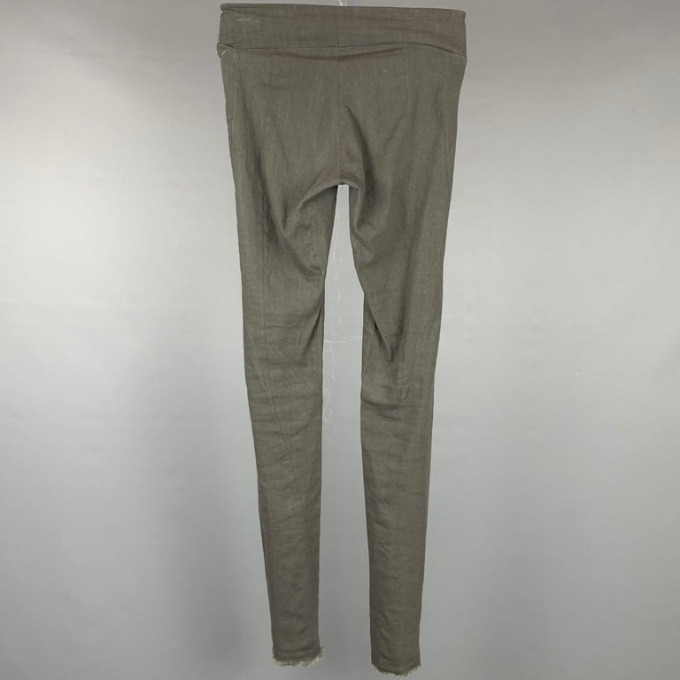 URBAN ZEN by DONNA KARAN leggings comes in a slate linen featuring a slip on style, fringe hem, and a skinny fit.  Good Pre-Owned Condition. Marked: 2  Measurements:  Waist: 24 in. Rise: 7 in. Inseam: 33 in.