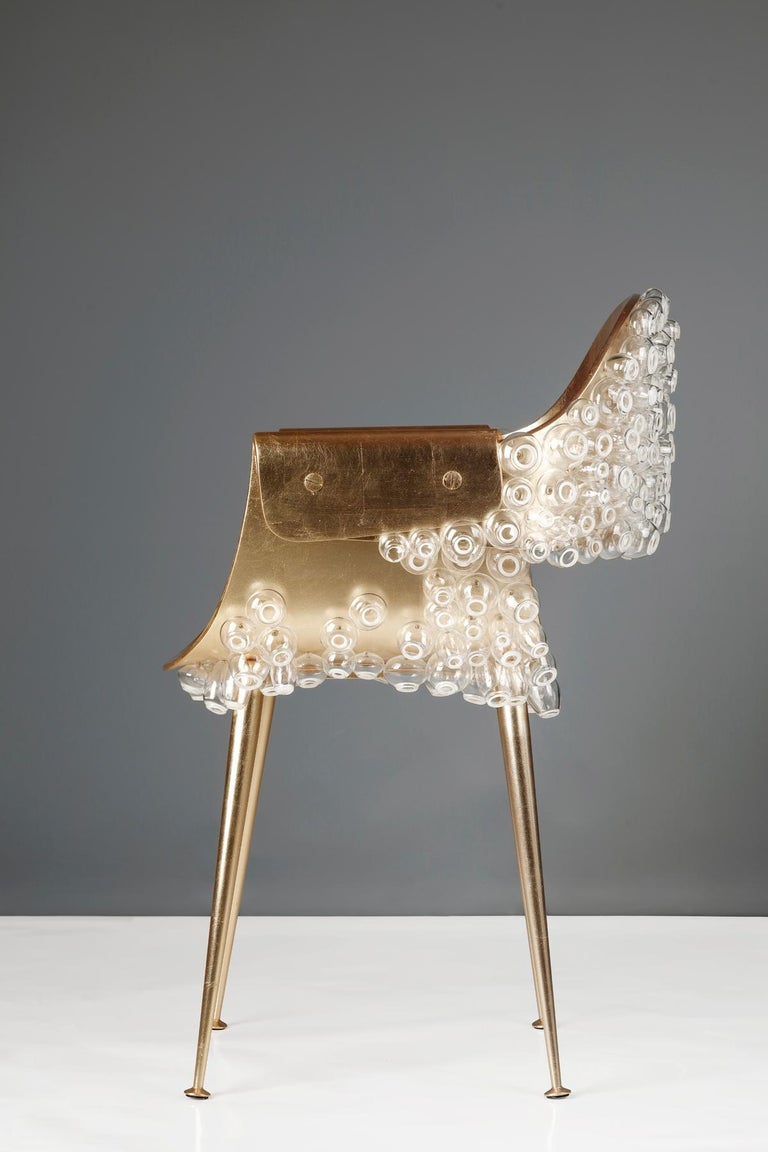 The traditional stability of metal and fragility of glass are juxtaposed in this dreamlike subaqueous chair. To rest in this chair is to collude in the subversion of conventional materiality, where one can be supported by barnacles made of glass.