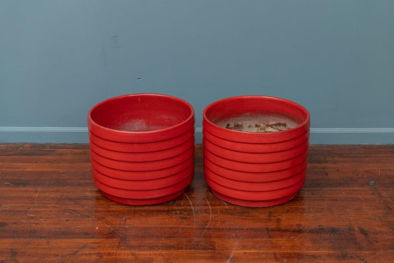 US pottery of paramount ring or ribbed pair of ceramic planters, actual color is more burnt orange than red. Large and impressive, great for the entry way or exterior garden pots.