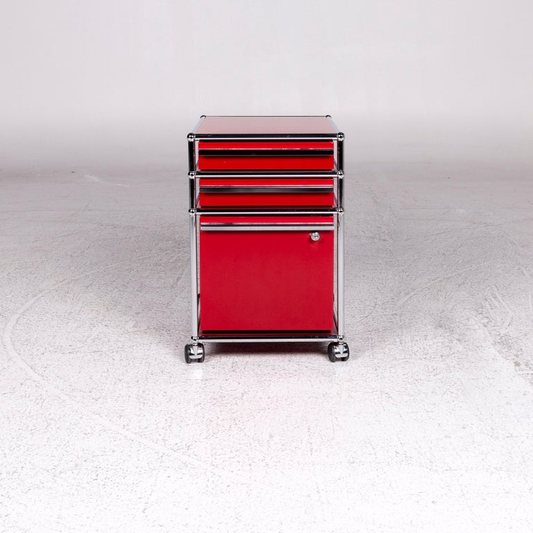 We bring to you an USM Haller metal container red sideboard rolls.      Product measurements in centimeters:    Depth 63 Width 42 Height 63.