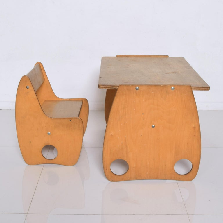 Collectible USSR Student Child School Kid's table desk and chair by Hans Mitzlaff & Albrecht Lange, 1960s. Constructed in beech veneer plywood wonderfully modern cutout design. Stamped USSR Dimensions: chair 17 1/4