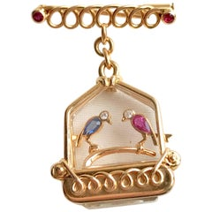 UTI Watch Caged Birds Brooch in 18 Carat Gold circa 1950 Ruby Sapphire Diamonds