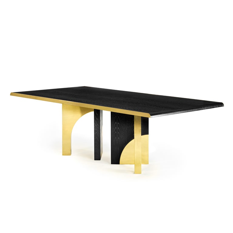 The Utopia dining table is designed in the likeness of the architectural scale that suggests a crossing through the structures of a utopian city, organized by the principles of symmetry and ideal forms. The imposing design combines dark oak and