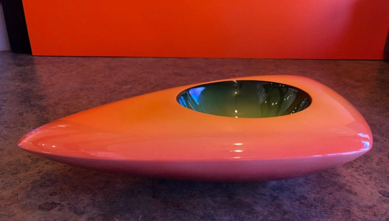 Vibrant model V-33 triangular earthenware bowl by California, artist Fred Stodder. The piece is signed and is 17.5