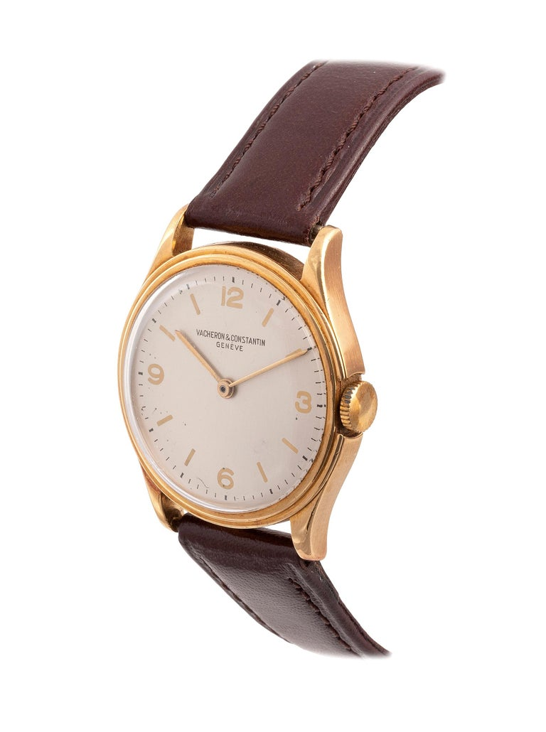 manual wind.Dial: White, applied beveled gilt hour markers and gilt numeral quarter hours, black outer minute track, subsidiary dial at 6 for seconds, gilt baton hands Case: Polished round, snap on back Strap/Bracelet: Black leather Buckle/Clasp: