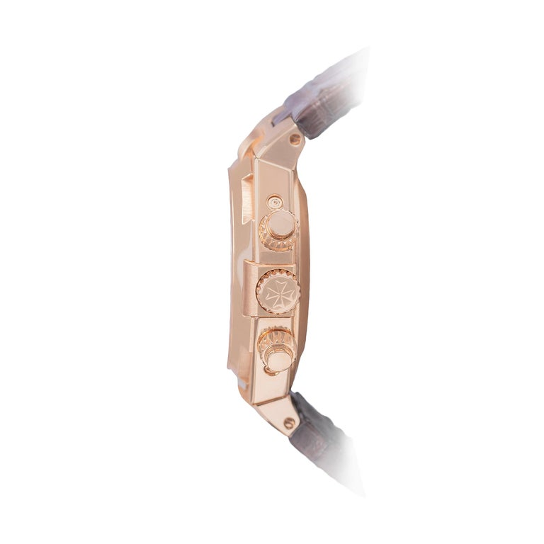 This watch, with 18k rose gold case,  has an automatic mechanical movement and power reserve up to 40 hours. The hazelnut glazed dial has 18k gold-plated hands and indexes, and four perpetual calendar counters.  The counter at 3 o'clock features the