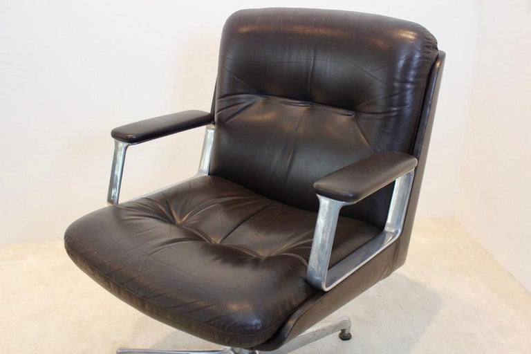 Executive office chair made by Vaghi 1960s, essentiality, simplicity, versatility. The chairs comes with swivel and ergonomic quality. The chair has very broad armrests and is height adjustable on an aluminum frame which is marked. Some slight signs
