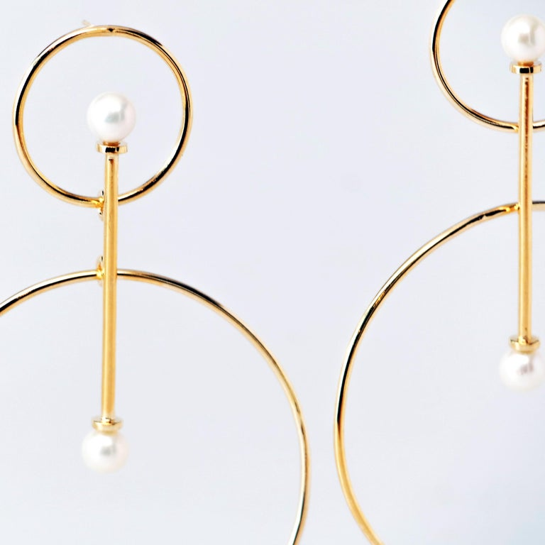 Handcrafted in recycled 14KT Gold and freshwater pearls (white or peacock color), these statement earrings were inspired by the celestial cosmic Buddha, Vairochana, meaning the Radiating One. This wearable art is the perfect statement piece that is