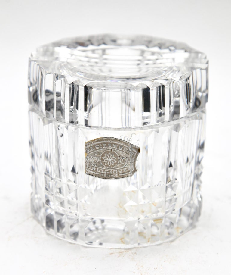 Val Saint Lambert vase, with label shown in various factory catalogues, 1950s. Beautiful Val Saint Lambert circular crystal vase, the glass is thick and clear. Origin: Belgium in excellent condition.   Photography fails to capture the simple