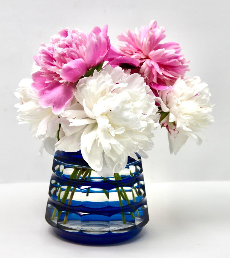 Vibrant, Cobalt Bleu cased-crystal glass 'Pique Fleurs' vase with a cut-to-clear Art Deco decoration  This design for vases is often called 'Pique fleurs' or 'rose-bowl' and is supplied with a fitted crystal grille to support stems in an