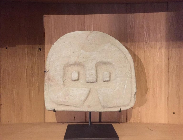 A pre-Colombian (Equador) stele depicting a abstract owl. These sculptures are typical for the Valdivian Early Horizon culture (2300-2000 BCE). This culture is among the oldest of the region and for their sculptures they used a pearly grey stone.