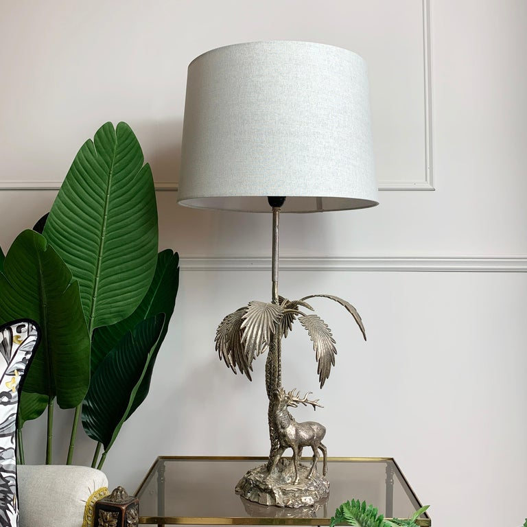 Valenti stag table lamp 1970's  Fine quality solid silvered bronze sculpture by the highly sought after Spanish artist Valenti This sculpture depicts a wild stag and palm trees  Signed Valenti, Made in Spain on the base at the back  The shade is