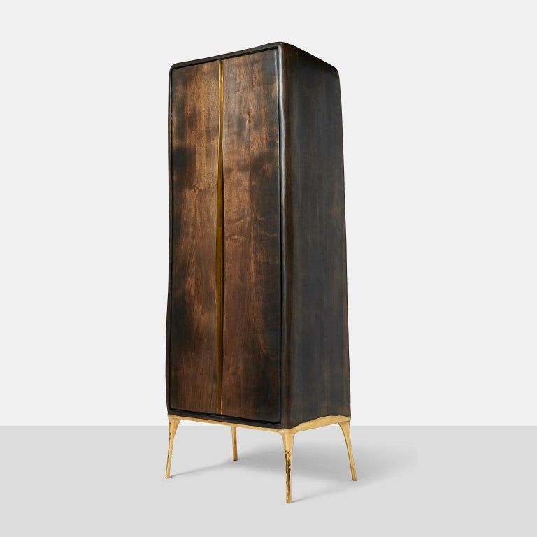 Valentin Loellmann, Armoire An organic shaped two-door armoire in walnut with brass lined doors and door pulls. The cabinet top has a downsloping shape to the back. Netherlands, c.2017.
