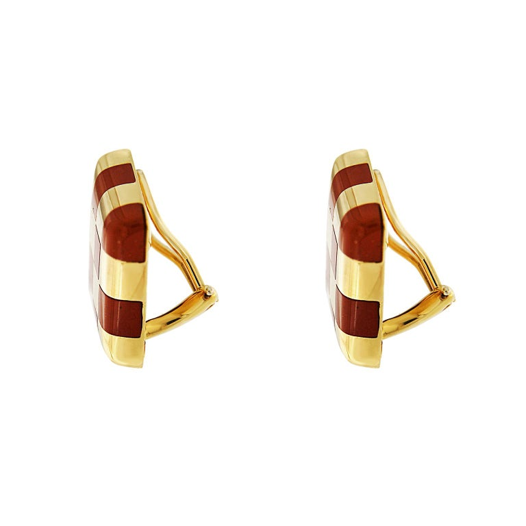 The earrings feature checkerboard pattern with jasper inlay. The earrings are completed in 18kt Yellow Gold and clips.