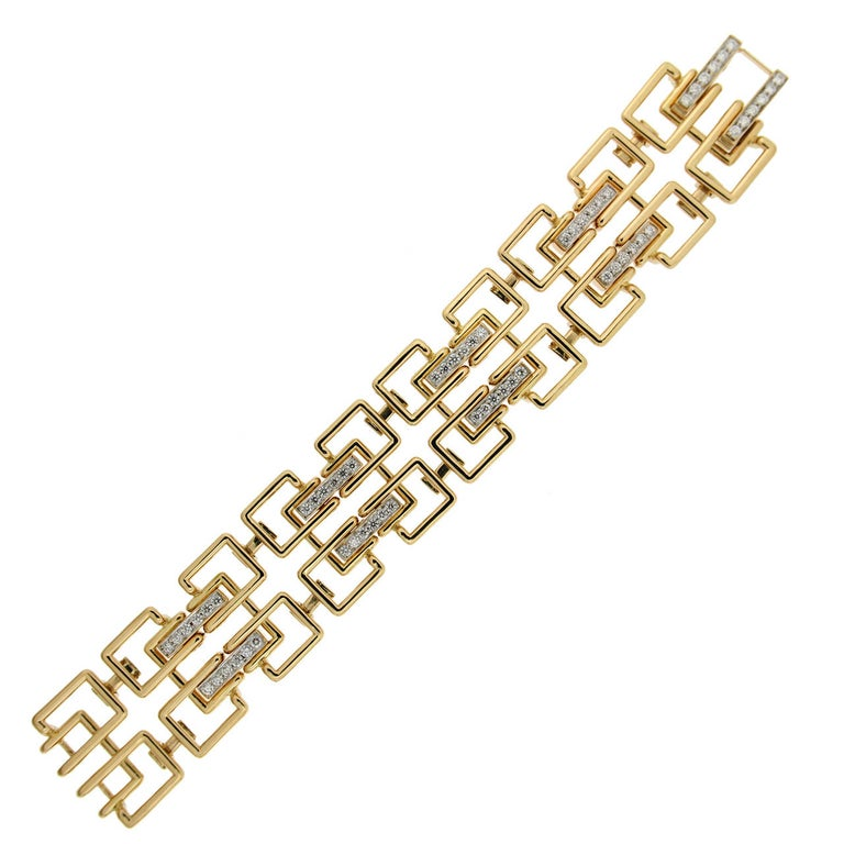 Art Deco's sleek geometry inspired this bracelet created by Valentin Magro. Much of the design is 18k yellow gold squares. Every four shapes interlock around a larger cousin, which is highlighted with round brilliant cut diamonds. Smaller links