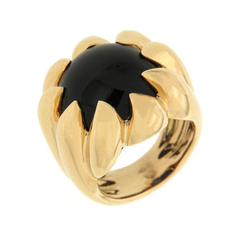 Valentin Magro Dome Pave Ring with Black Onyx in Yellow Gold. The band is 18k yellow gold, topped with an onyx cabochon. As the shank reaches the jewel, it forms claw prongs, holding the gem in place. Everything is polished to its strongest