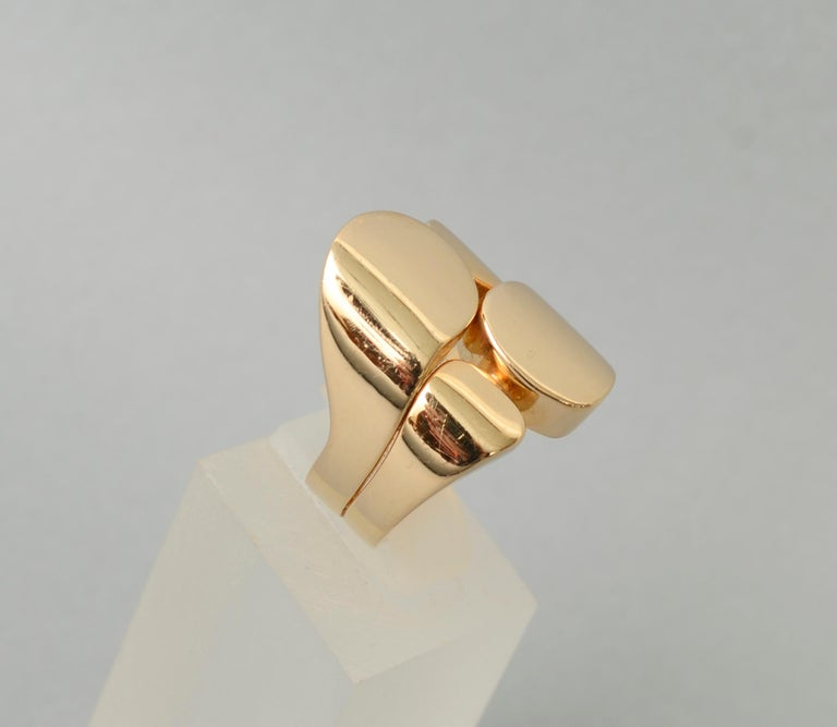Fabulous modernist design gold ring by Valentin Magro. Although the ring is actually fairly contemporary, it is very much in the modernist style. It is wonderfully bold and would be effective on a man or woman. The ring measures one inch from front