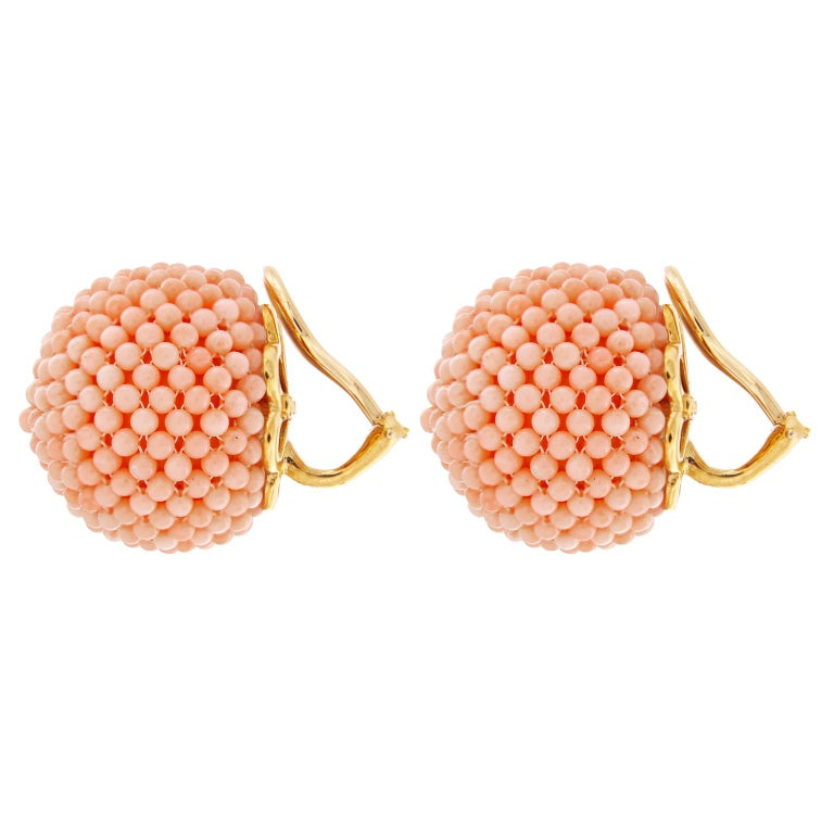 Pink coral is the star of these earrings. The recycled gemstones, are carved into beads and woven together to create jeweled balls. They are finished with 18kt yellow gold clip backs.   Measurement detail - width 0.96 inches (24 mm), length 0.96