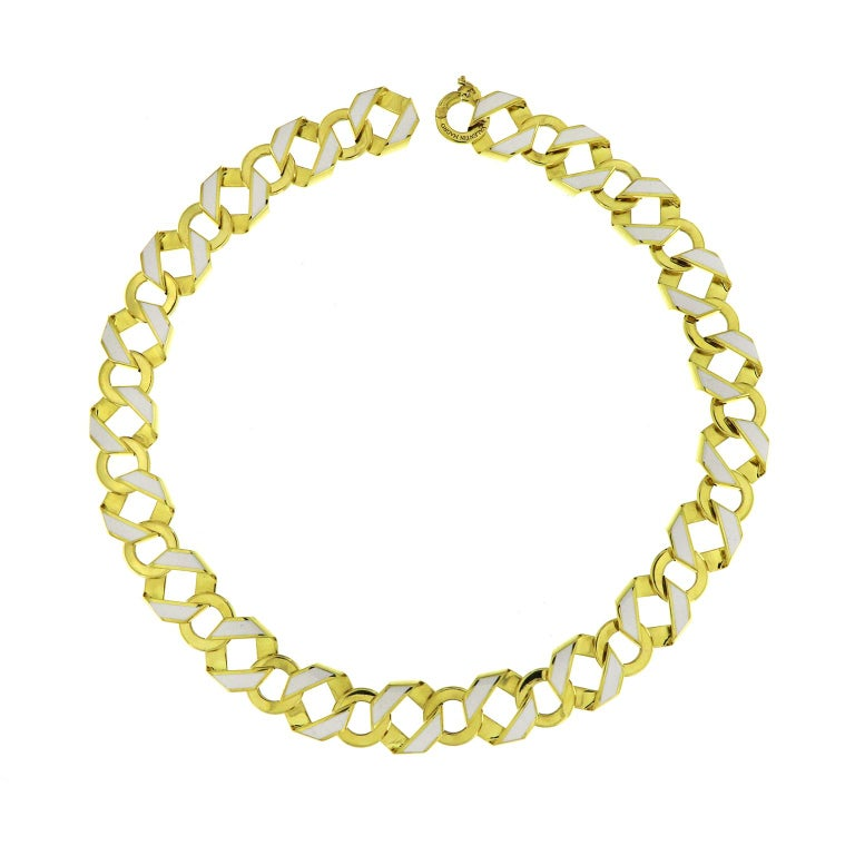This reversible necklace is made in 18 karat yellow gold features fold over links with white enamel on one side and black enamel on the other side.