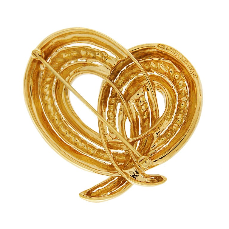 3366b269c This 18k yellow gold brooch created by Valentin Magro, creates a simple knot.  Its