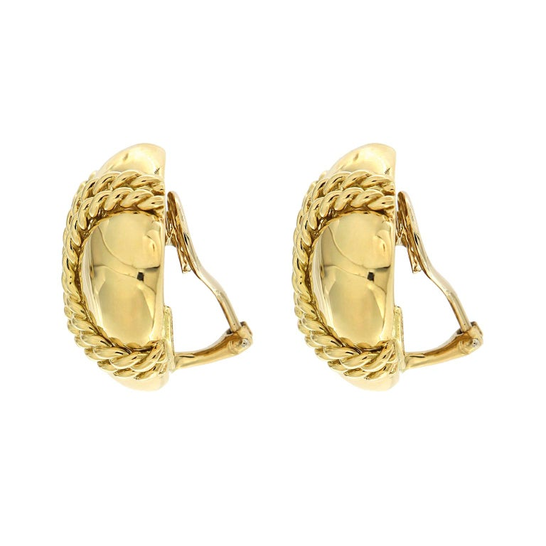 These diamond-shaped earrings created by Valentin Magro are all gold. The base is smooth polished 18k yellow gold. Double rows of twisted gold rope crisscross the fronts. Clip backs keep the earrings secure.   Measurement detail - width 0.98 inches