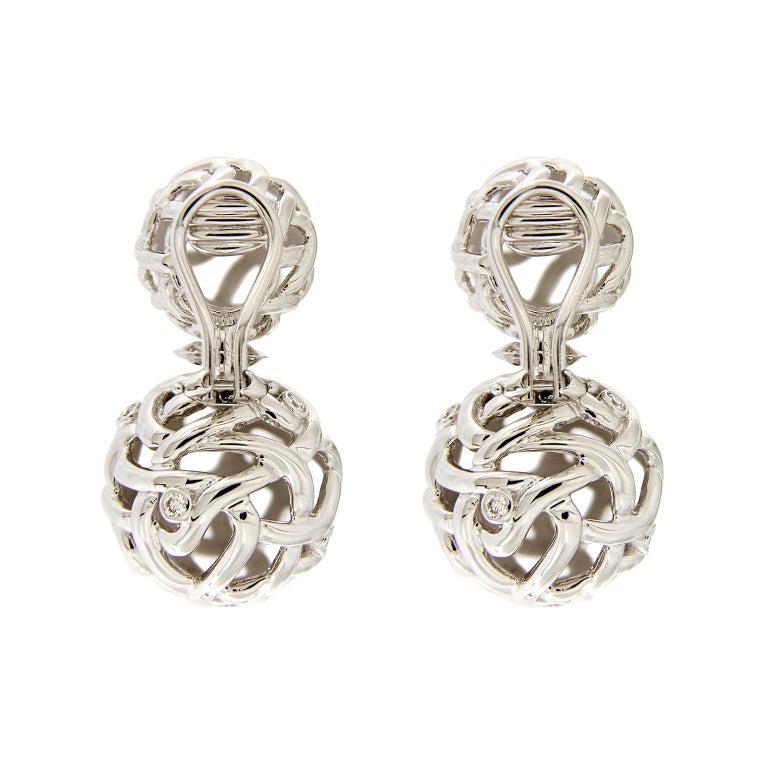 d747e064c1413 These drop earrings features unexpected fire. The bodies are 18k white gold  which weave and