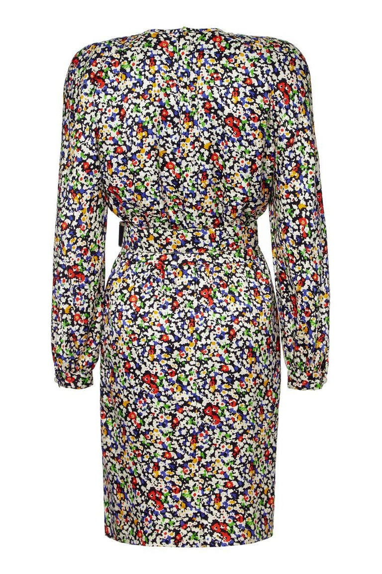This vibrant 1980s silk dress with matching belt by Valentino is in superb vintage condition and is easily adaptable to suit a variety of occasions. The fine abstracted floral print is subtly textured and blends between monochrome and bursts of