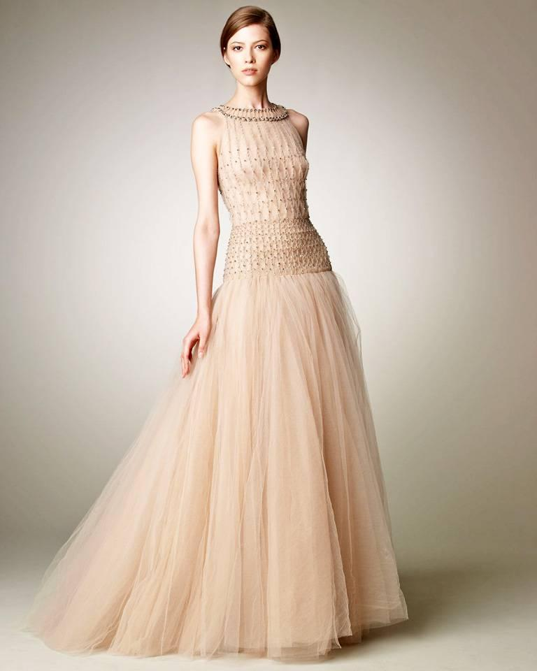 A lovely ethereal Valentino gown fashioned of pale pink silk net and tulle.  Bodice constructed of hand smocking detail showered with sequins.   Skirt has about  (7) layers for fullness designed to create fullness and drama.  Back zipper closure.