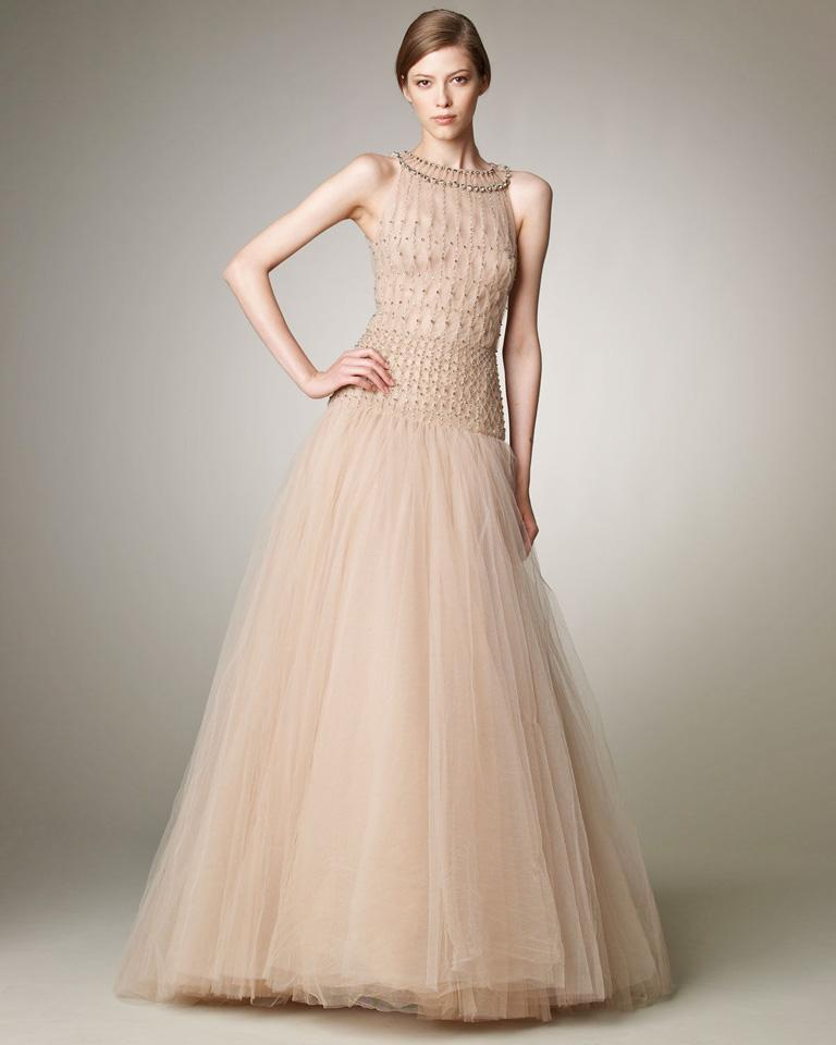 A lovely ethereal Valentino gown fashioned of pale pink silk net and tulle.  Bodice constructed of hand smocking detail showered with sequins.   Seven (7) layers designed to create fullness and drama.  Back zipper closure.   Gown is offered new with