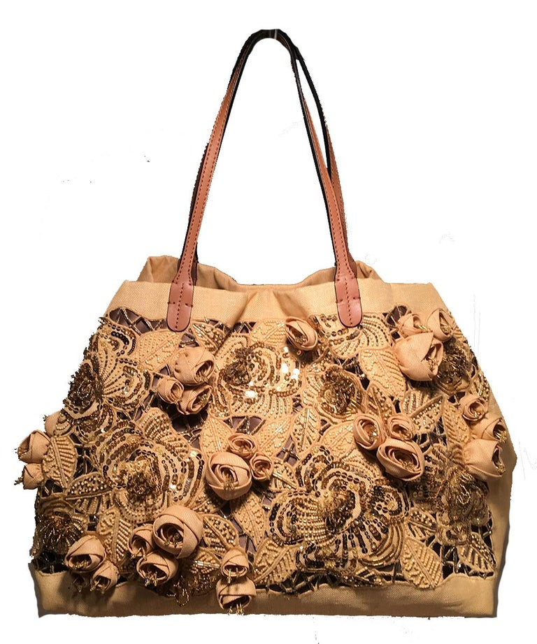 Valentino Beige Canvas Floral Sequin Tote Bag in excellent condition. Natural beige woven canvas exterior trimmed with light brown leather and silver hardware. Front exterior side features laser cut, embroidered, sequined, and 3D rosettes in a