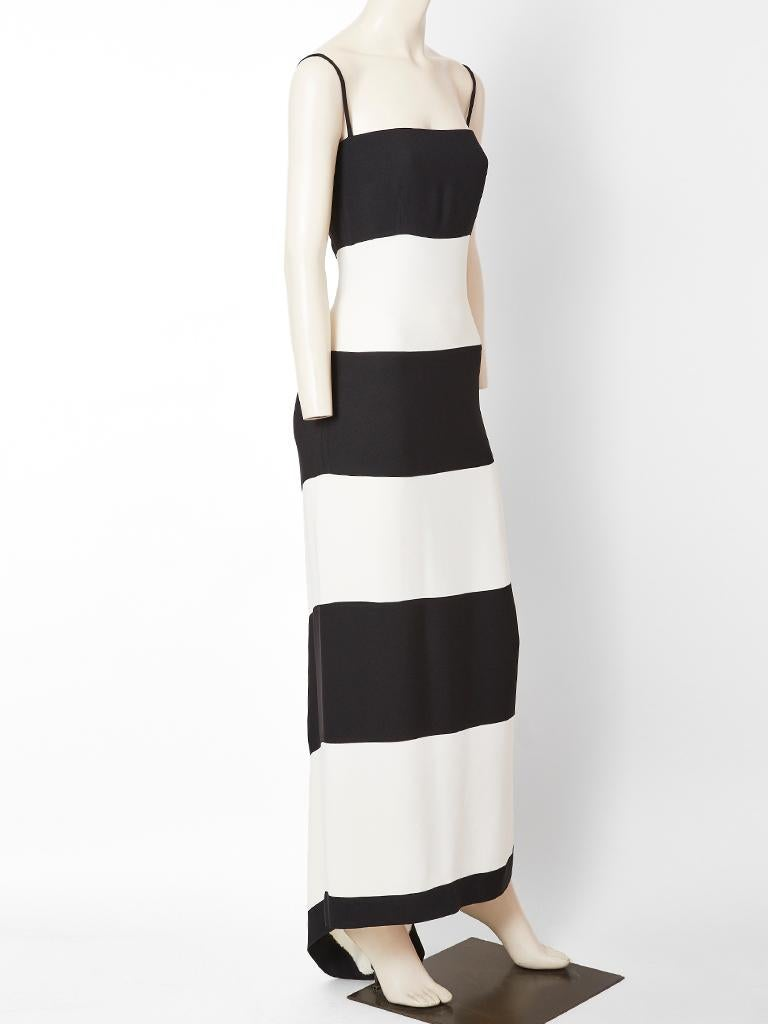 Valentino, three ply crepe, simple, black and white evening dress having wide, horizontal, black and white stripes in the front and a bias placed chevron panel in the back with a small train. Dress has a narrow silhouette held up by thin spaghetti