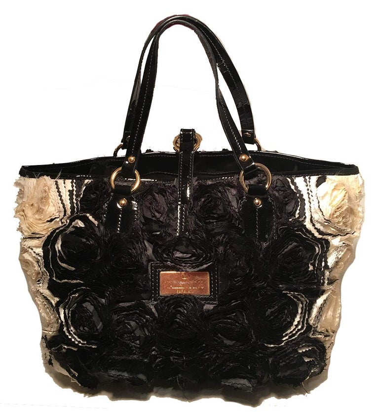 Valentino Black and White Silk Rosier Roses Tote Bag in very good condition. Black and white silk organza rosettes embroidered throughout the exterior. Black patent leather trim and gold hardware. Top strap buckle closure opens to a black silk