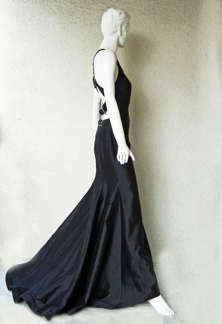 Valentino high fashion stunner from one of the designer's most exciting and sold out collections of 2001. Sleeveless racer back gown fashioned of black shantung silk. Criss-cross double strap back adorned with clear Swarovski crystal adjustable