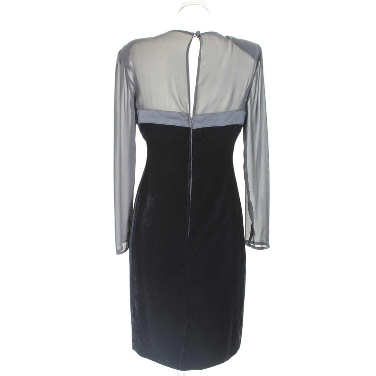 Valentino 90s vintage dress in silk and velvet, black with transparent sleeves and shoulders. Elegant long evening dress made in Italy, the velvet part has raised wefts that change in correspondence to the light. Excellent vintage conditions  Size