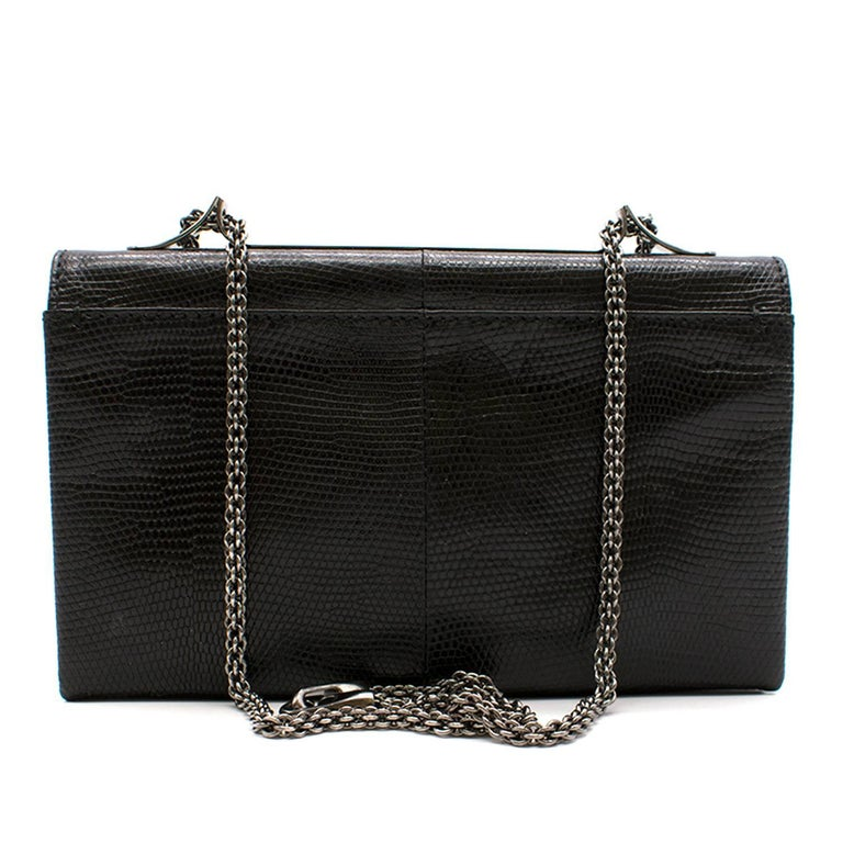 a1ca84c85c6 Valentino black leather clutch bag. The bag includes a gunmetal grey metal  strap. It