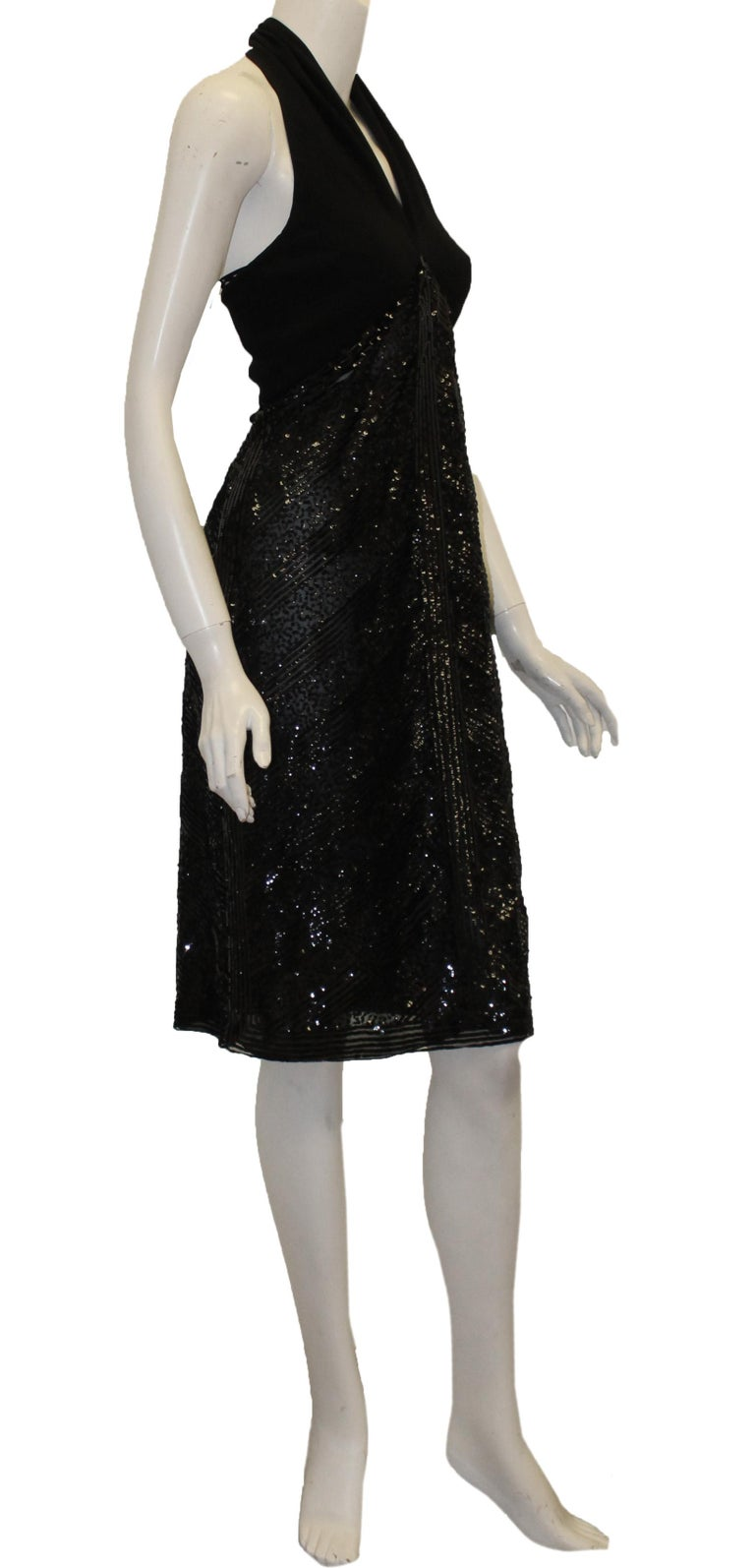 f79a4fe4cc86 Valentino black halter cocktail sequined dress is accentuated by a plunging  neckline and open back.