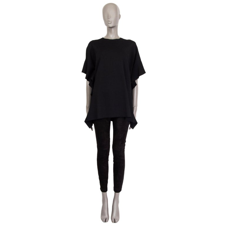 Valentino short-sleeve knit blouse in black viscose-blend (assume as tag is missing) with a crew-neck and ruffled-seams. Unlined. Has been worn and is in excellent condition.   Tag Size Missing Size Size S Shoulder Width 41cm (16in) Bust 122cm