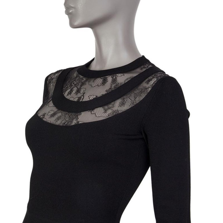 alentino long-sleeve knit dress in black viscose (83%), polyester (17%), and silk (100%). With crew neck, lace details around the neck, and a-line skirt. Closes with invisible zipper on the back. Unlined. Has been worn and is in excellent condition.