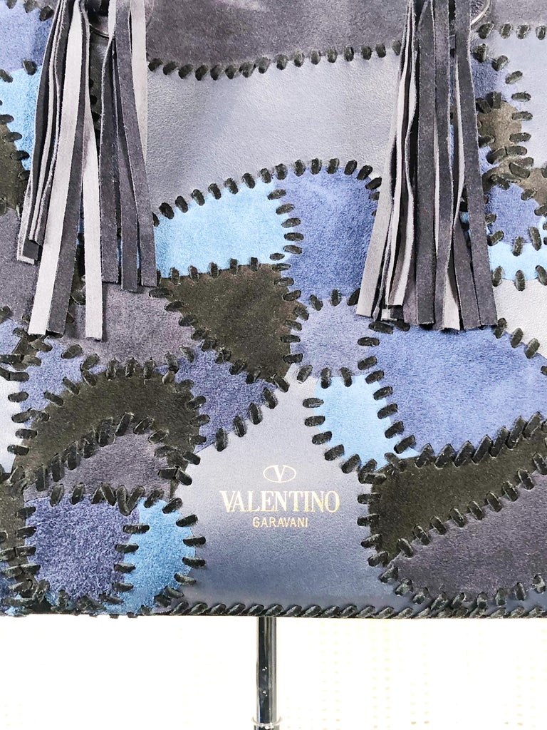 Valentino large patchwork leather butterfly tote bag in shades of blue and black with leather stitchwork. Leather fringes at handles. Condition: Next to new.