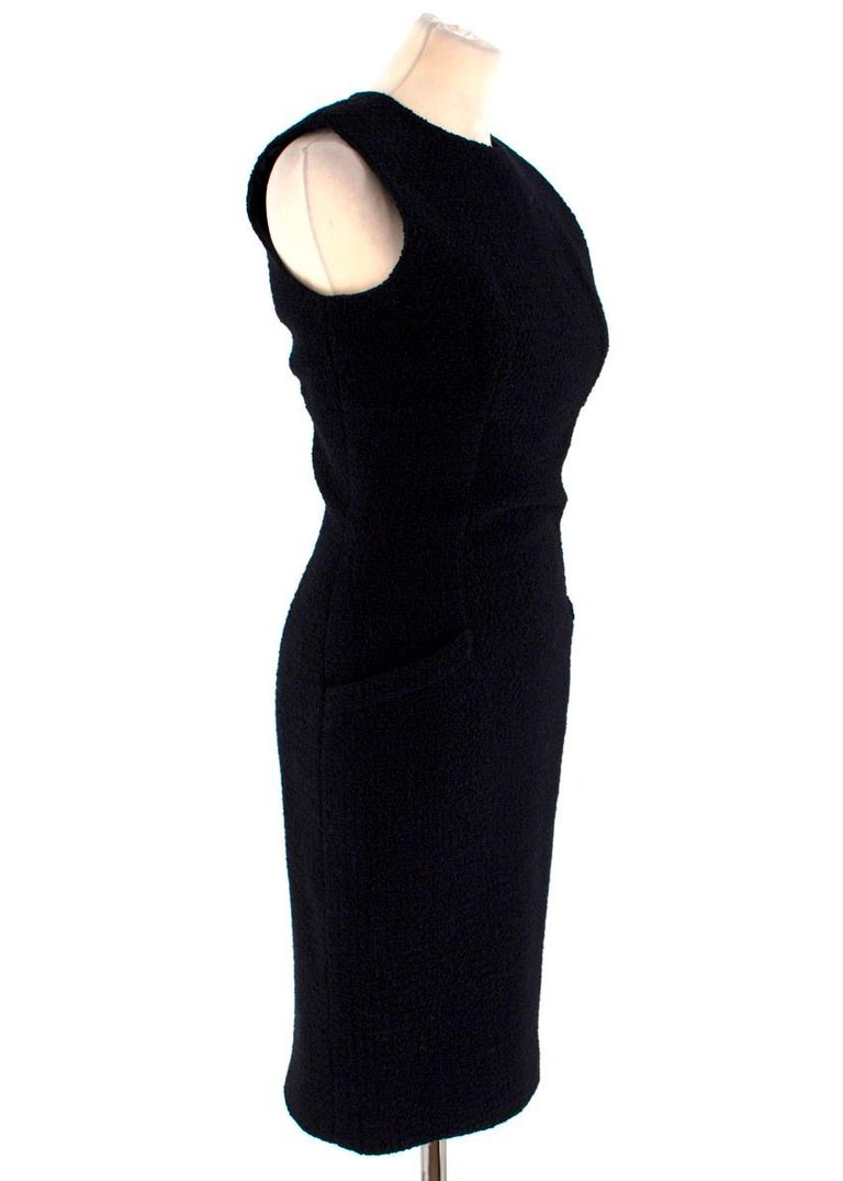 Valentino Boutique Black Fitted Dress  -Vintage black fitted dress which is tailored around the bust and waist -Sleeveless knee length dress -Two front pockets -Back zip closure  Please note, these items are pre-owned and may show signs of being