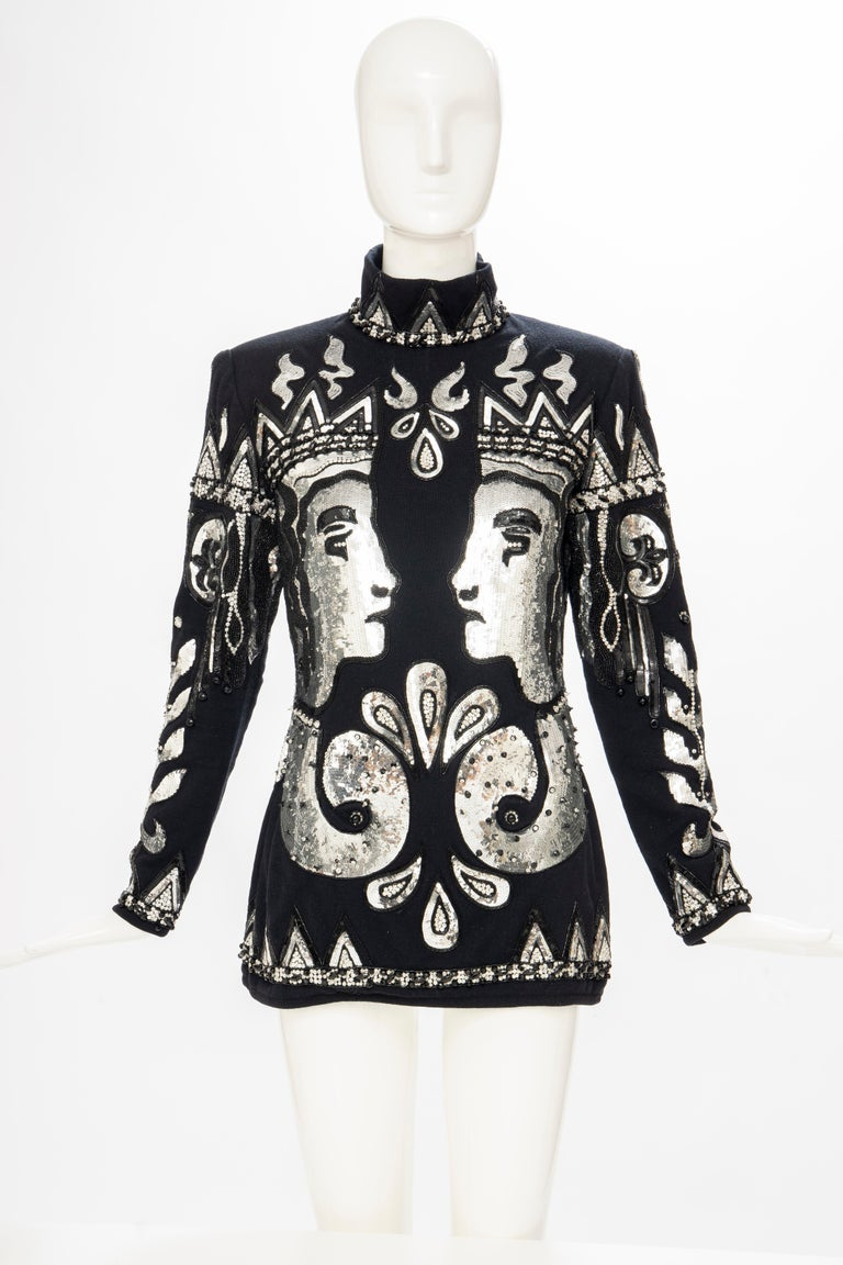 Valentino Boutique, Fall-Winter 1989-90, black wool trurtleneck sweater embroidered with silver & black sequins with black beadwork, back zip and fully lined in silk chiffon.   The sweater was inspired by Etruscan Pottery and is part of the