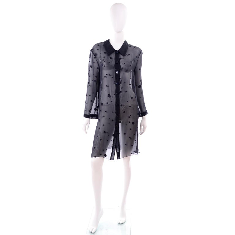 This beautiful long button front blouse or shirt dress is in a sheer midnight blue silk with tonal silk dot appliques with raw edges. It has iridescent dark blue buttons down the center front and a deep neckline with collar and high slits on both
