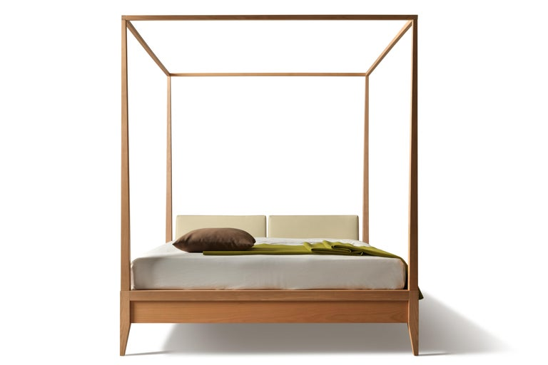 Valentino, '900 style canopy bed made of cherrywood with upholstered headboard. Available in different sizes: king, queen, California king. The price of this listing refers to a 180 x 200 size.