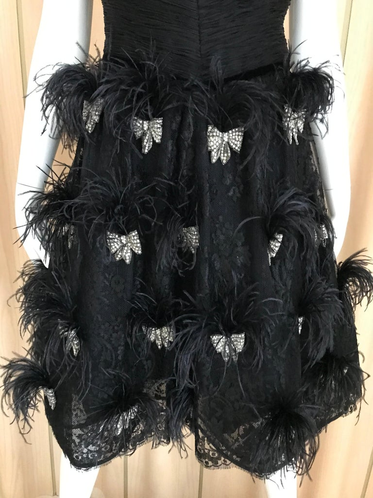 Sexy and Fun Black Silk VALENTINO COUTURE spaghetti strap cocktail dress with ostrich plume. Bust: 36 inches/ Waist: 30 inches/  Dress length: 38 inches