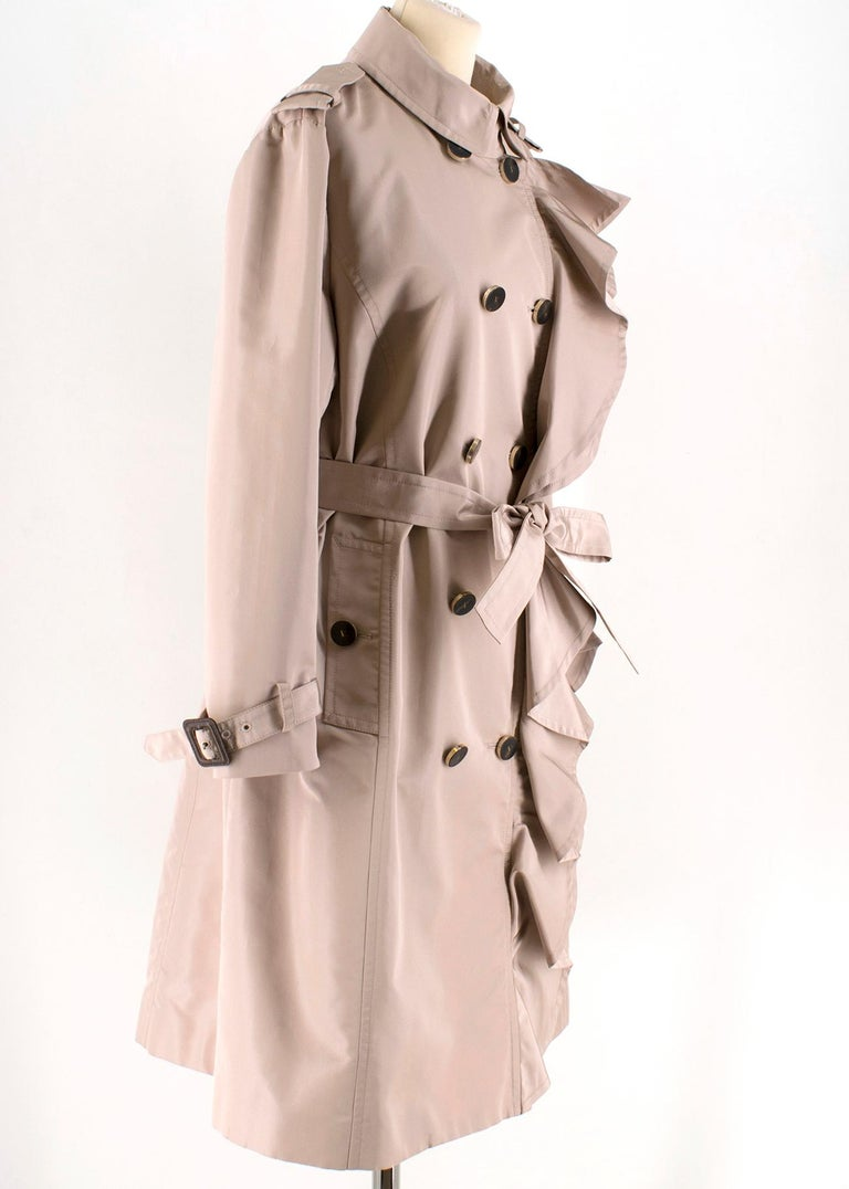 Valentino Dust Pink Silk blend Trench Coat  - dust pink trench coat  - lined - wood button fastening - ruffle detail to the front  - belt and belt hoops - leather buckle details to the sleeve - slip pockets  Please note, these items are pre-owned