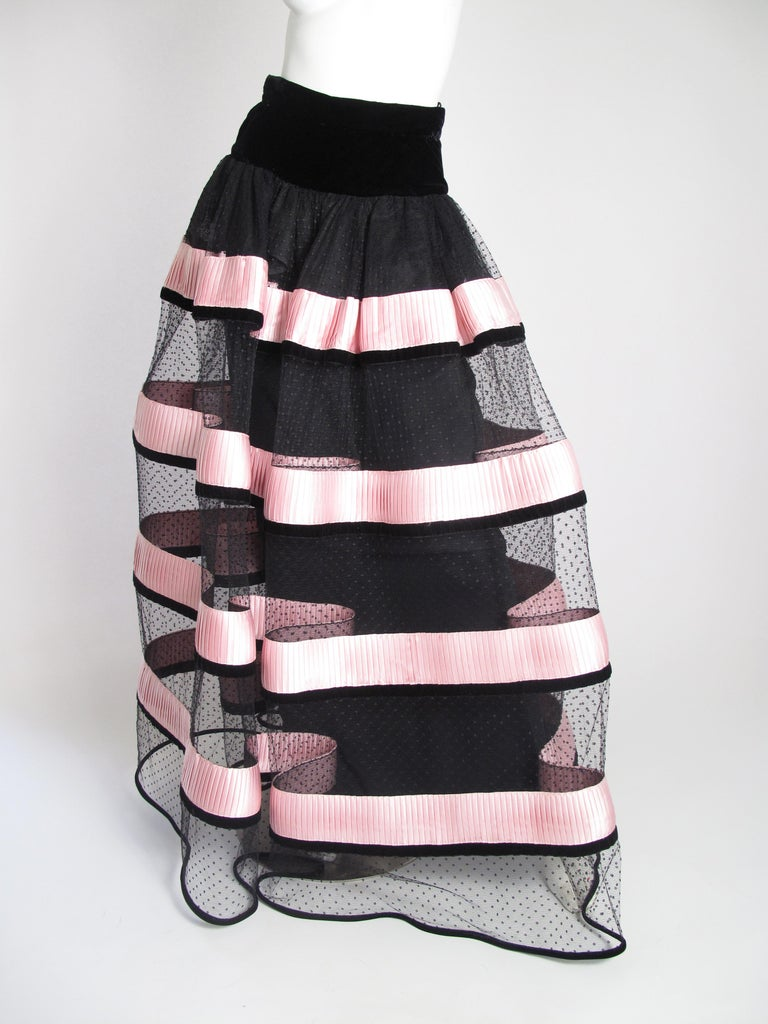 Valentino net evening skirt with pink ribbon trim. Black fitted underskirt. Condition: Excellent. size S ( too small for size 6 mannequin, see photos )