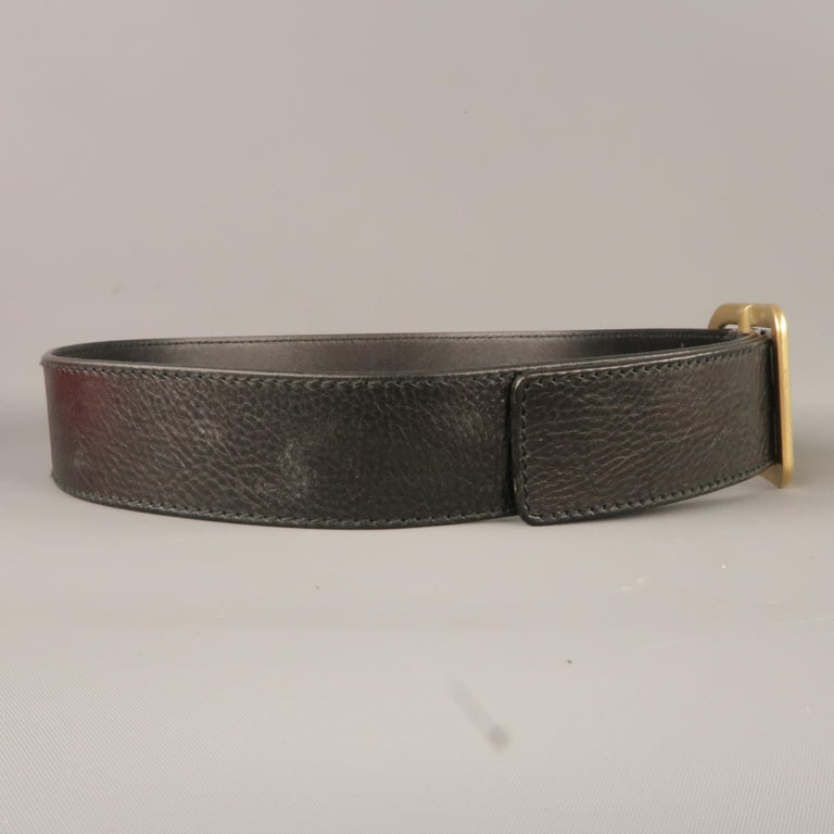 VALENTINO GARAVANI belt comes in a black leather featuring a gold tone buckle. Made in Italy.   New With Box. Marked: 35/34   Length: 38 in. Width: 1.8 in. Fits: 30 - 34 in. Buckle: 2 in.