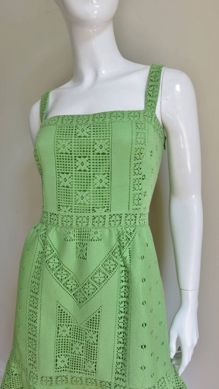 A beautiful green Guipure lace dress in an intricate flower and geometric motif from Valentino.  It has a fitted bodice with 1