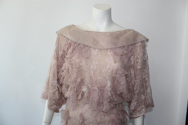 Valentino blush pink lace dress with lace applique throughout. Draped open back with crossover surplice skirt. Button snap closure.  New with tags, but minor snags throughout. Size S 100% silk